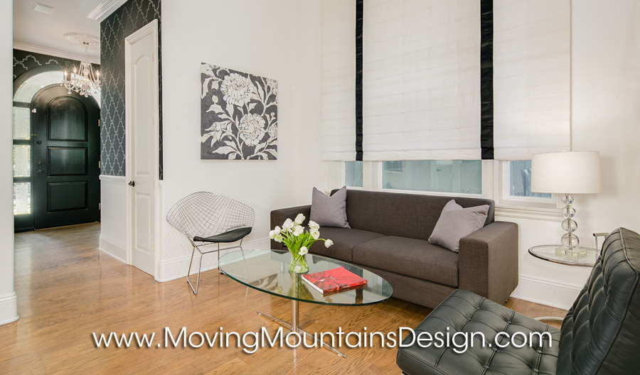 Modern living room home staging gray glass and chrome