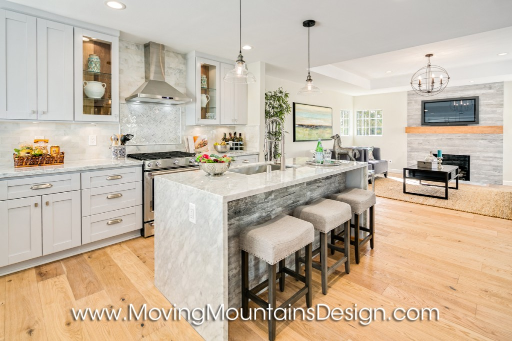Open plan kitchen home staging with barstools and marble counter