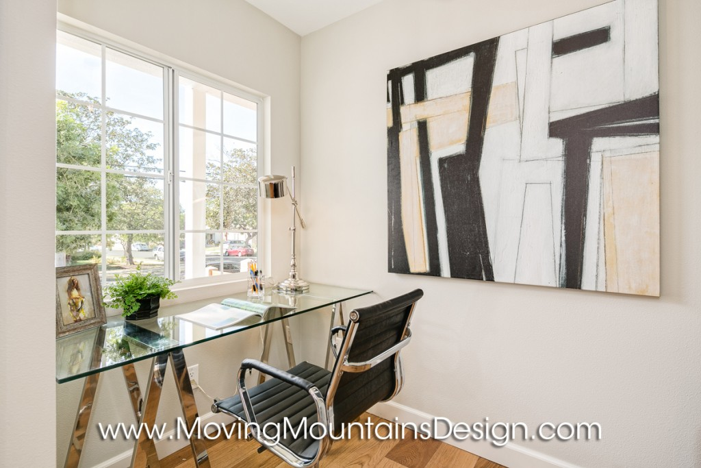 Office home staging with glass desk on chrome saw horses