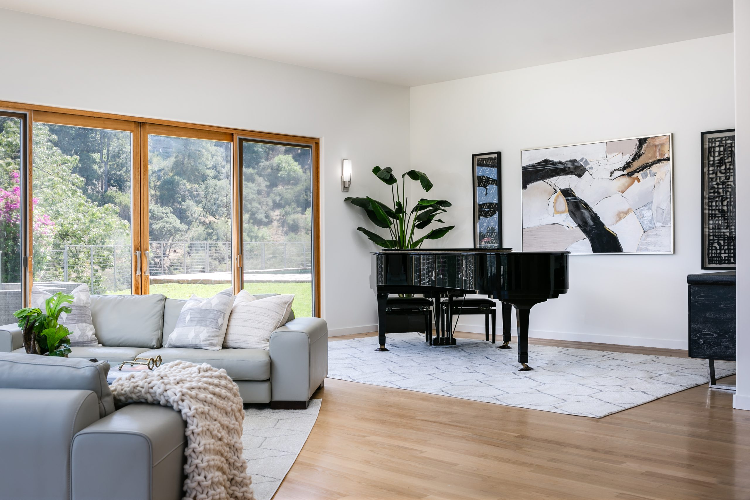Contemporary home staging with baby grand piano